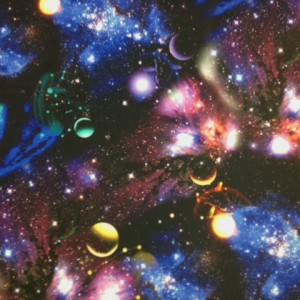 Galaxy stretch print of stars and planets on stretch fabric
