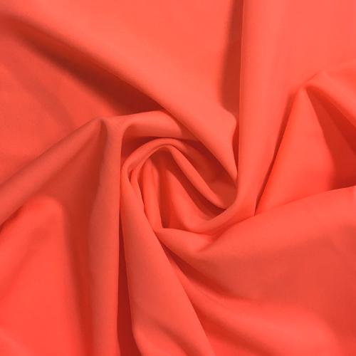 Salmon Kira Matte Tricot Spandex, orange fabric, orange swim fabric, swim fabric, swimwear fabric, tricot fabric